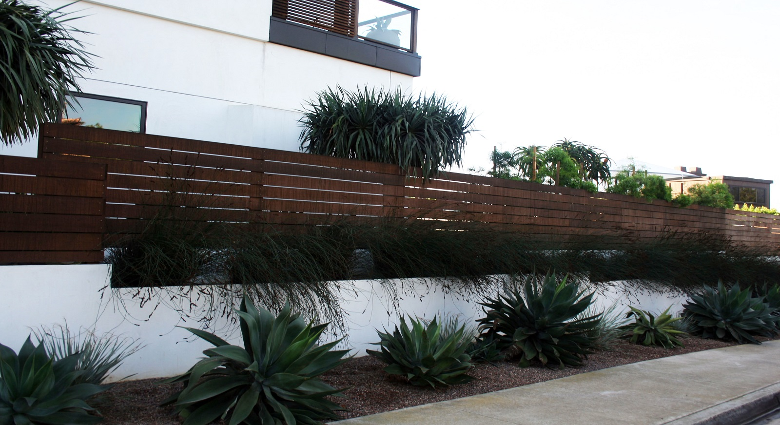 cross construction remodel landscape retaining wall stucco fence
