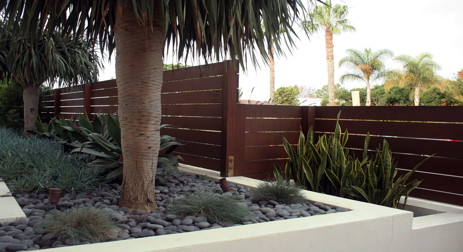 cross construction remodel landscape fence retaining wall