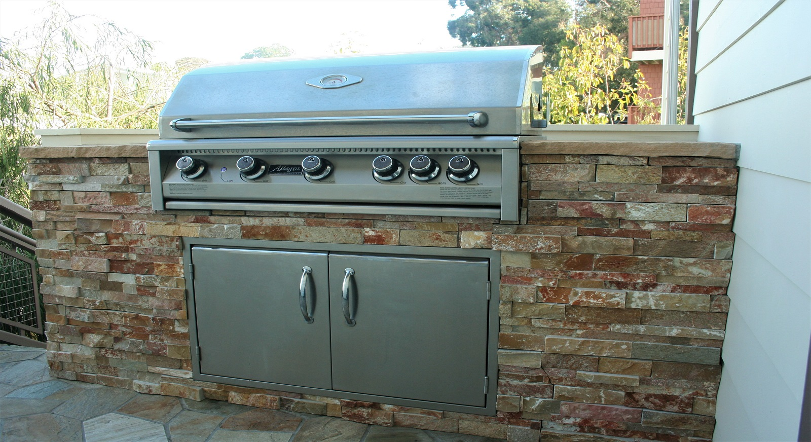 cross construction remodel landscape outdoor kitchen grill