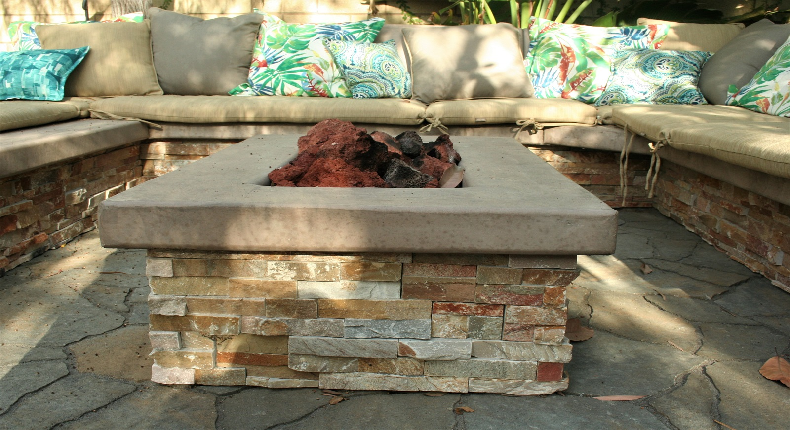 cross construction remodel landscape outdoor seating fire element stone