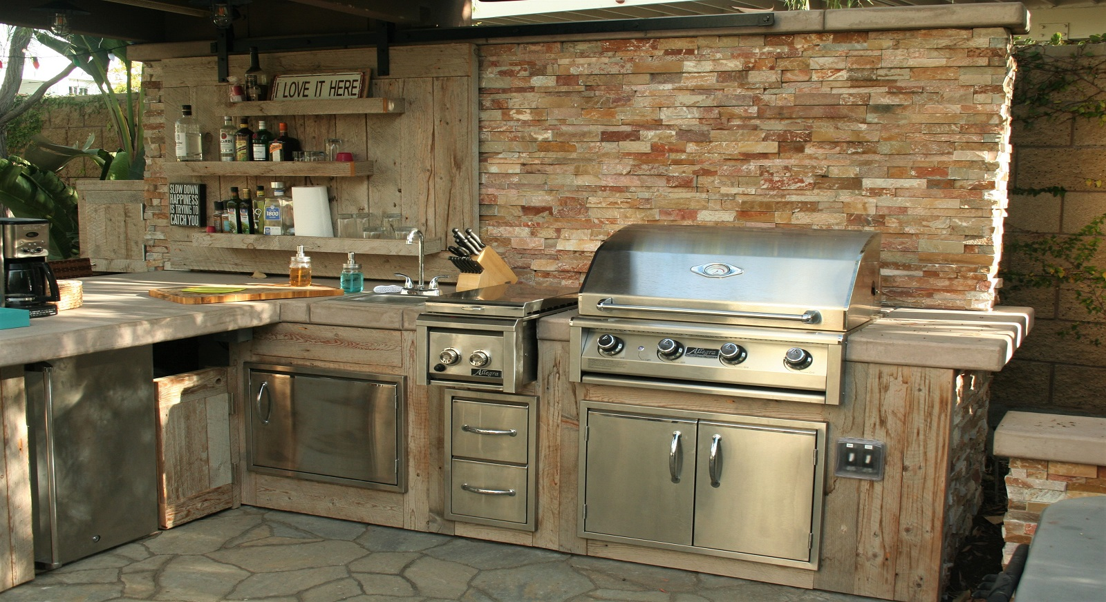 cross construction remodel landscape outdoor kitchen grill stone